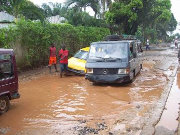 This was a fairly normal scene during the rainy season. Roads are... well... not exactly maintained. It makes for some hilarious situations, unless you're the one stuck in the taxi.